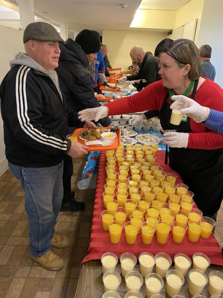 Christmas breakfast is served by volunteers buffet style
